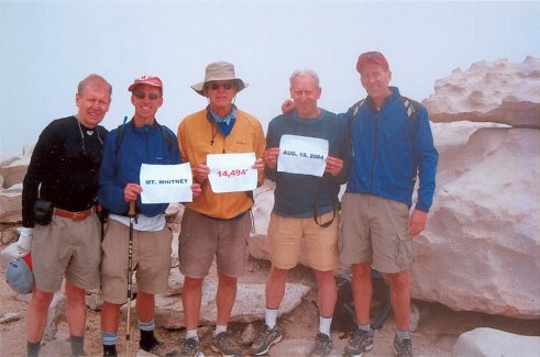 A handful of the Ridge Runners take in the view atop Mount Whitney in 2004, one of more than a dozen such trips made by members of the group. From left to right: Lynn Borland, Troy Elander, Frank Gibbons, Jon Varat and Ron Graham.