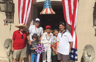 Fourth of July Home Decorating contest judges (left to right) Jack Sutton, Kevin and Gable Nealon, Joan Sather, Daphne Gronich and Rob Weber award the Sponsor prize to the Ramsey home on Alma Real.