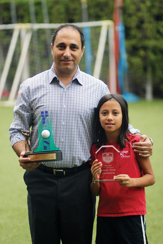 Dr. Ashraf Elsayegh holding his daughter's Hole-in-One trophy and Kaila who was the local tour champ in her age group.