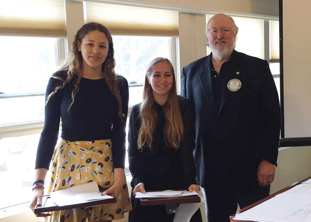 Zaire Armstrong and Talia D'Amato were given writing awards by Rotary member David Card.