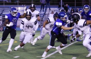 Running back Stone Maderer looks to slip by the Sierra Canyon defense. Credit: Drew Vaupen