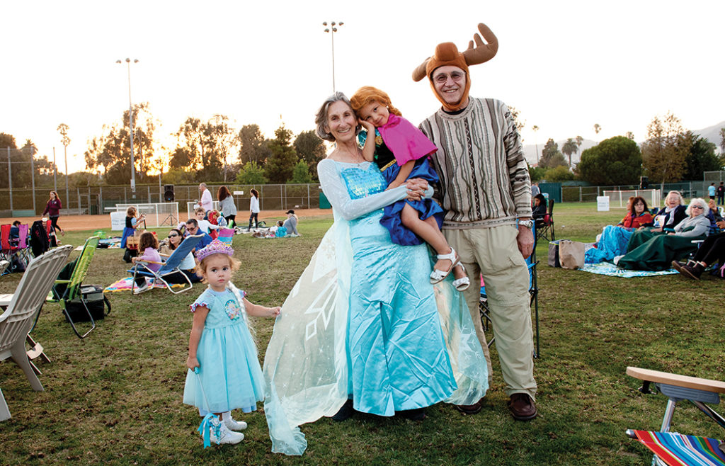 "Everyone dressed up for ""Frozen"": (left to right) Cleary Herzlinger, Dana Fein (Marquez Elementary 2nd grade teacher) holding granddaughter Rachel and Sumner Fein"