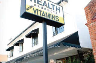 Diane Berk, owner of All-Pro Health and Nutrition, in front of the store on Via de la Paz. Photo: Lesly Hall