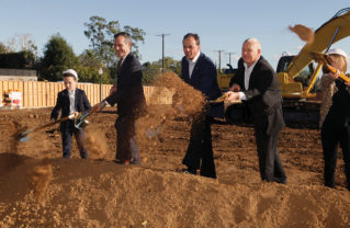 Palisadians Gavin Alexander (left) and Sophie Herron (right) joined Mayor Eric Garcetti, developer Rick Caruso and L.A. City Councilmember Mike Bonin for the official Palisades Village groundbreaking ceremony on Swarthmore on October 28. Photo: Bart Bartholomew