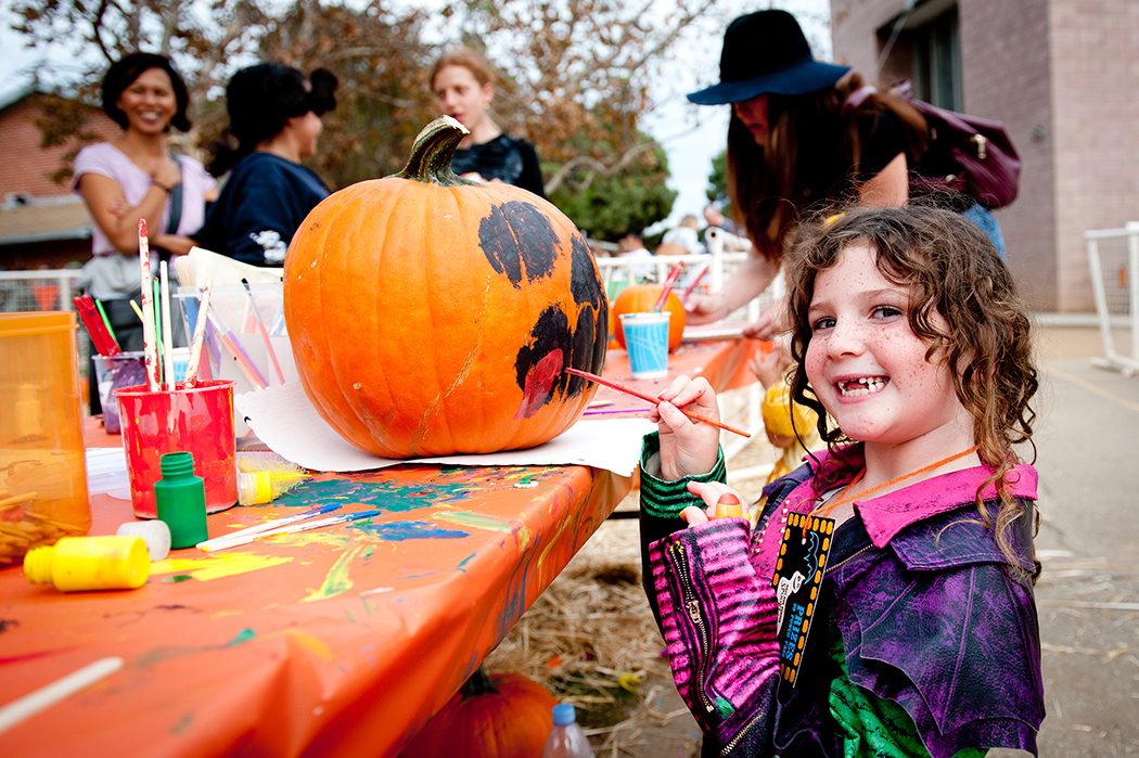 Daisy Moussavi, 5, decorates a pumpkin at the arts and crafts table at the annual Recreation Center Spooktacular.Photo: Lesly Hall
