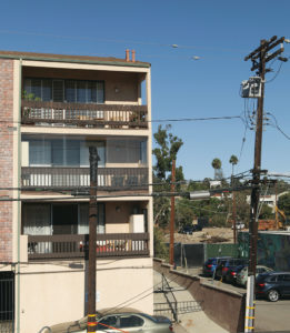 This utility pole, located 10 feet from another one, blocks condo owners' views. Photo: Bart Bartholomew