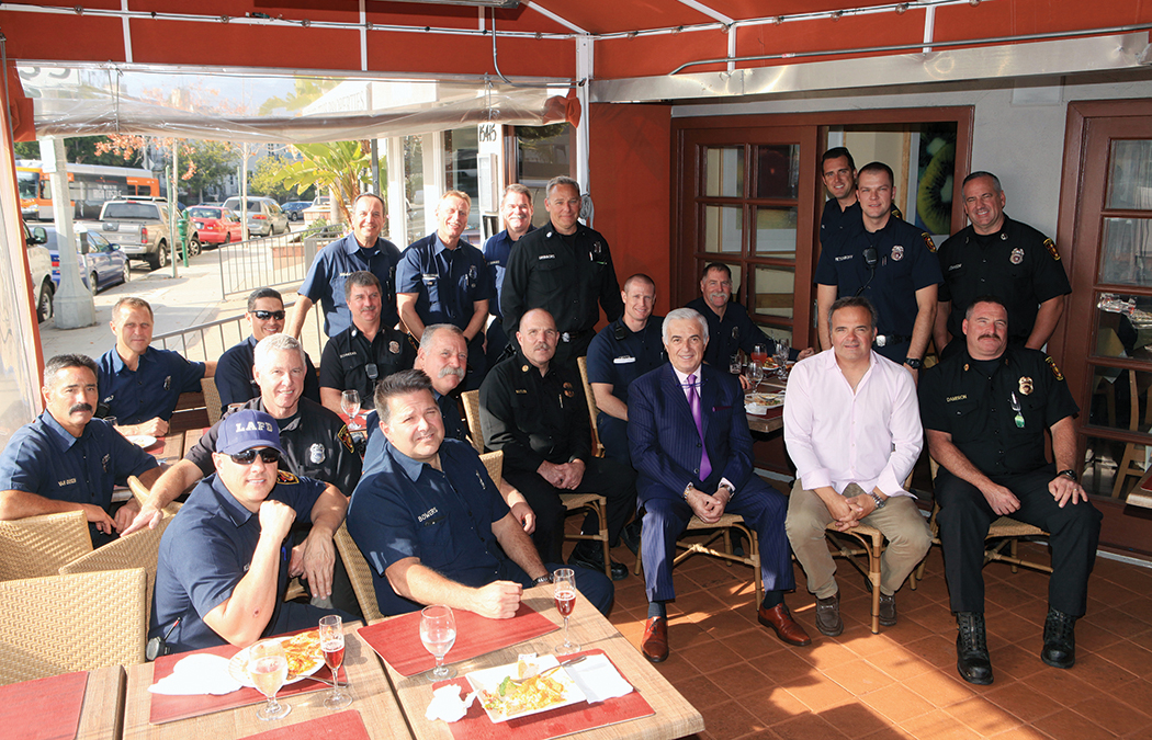 L.A. firefighters, police officers and Chrysalis workers were honored at a luncheon at Il Piccolo Ritrovo, hosted by the Palisades Business Improvement District on December 14. Ritrovo owners Tarcisio Mosconi (purple tie) and Nando Silvestri oversaw the event. Photo: Bart Bartholomew