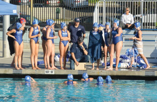 Coach Kirk Lazaruk listens during a time out. Photos: Peggy Saab