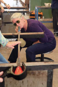 Artist Terry Bromberg blowing glass.