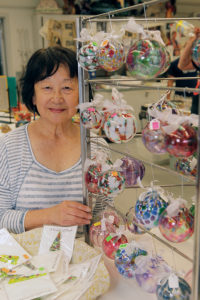 Palisadian Dorothy Miyake sells her Christmas ornaments at the SMC open house.
